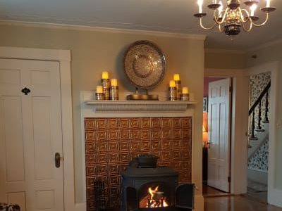 room with iron fireplace with blazing fire