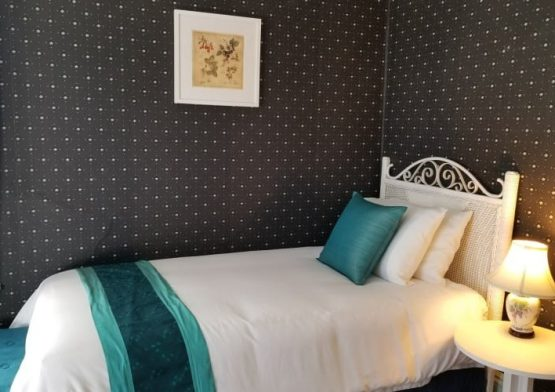 bedroom with twin bed decorated with aqua accents