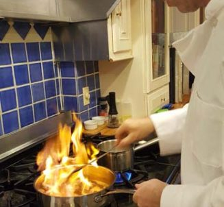 Chef cooking with flaming pan