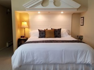 bedroom with brown accents and dramatic headboard