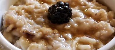 oatmeal with blackberry on top